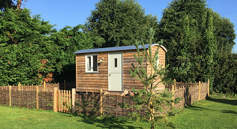 Shepherds hut at Grove Farm Holiday Barns in Catfield Norfolk.